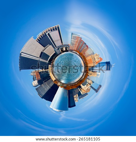New York City 360 degree panorama, in a sphere that seems to be floating in the blue sky. Manhattan as a tiny planet with buildings jutting out into space. - stock photo