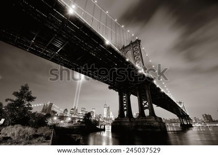 New York City downtown and september 11 tribute at night with Manhattan Bridge - stock photo
