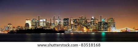 New York City downtown night skyline panorama over Hudson river with skyscrapers. - stock photo