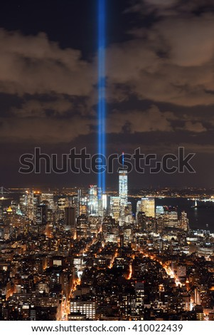 New York City downtown skyline view at night with September 11 tribute light. - stock photo