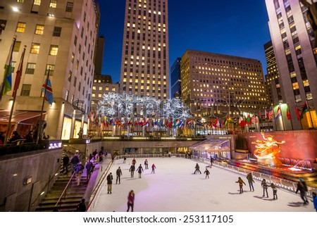 NEW YORK CITY - FEB 11: Ice skaters and tourists are all around the famous Rockefeller Center  during the holidays on February 11, 2015 in Manhattan, New York City. - stock photo