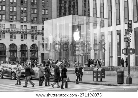 NEW YORK CITY - FEB 13: Shopping street at 5th Avenue in NYC with tourists on  February 13, 2015. It is considered among the most expensive and best shopping streets in the world. - stock photo