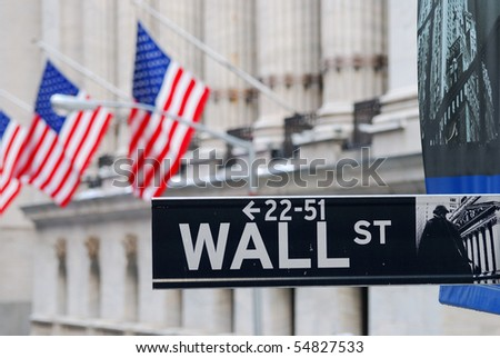 NEW YORK CITY - FEB 3: Wall Street road sign and New York Stock Exchange during United States economy recovery, February 3, 2010 in Manhattan, New York City. - stock photo