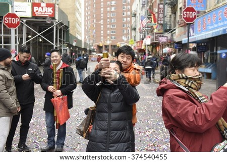 NEW YORK CITY - FEBRUARY 8 2016: day one of the Chinese Lunar New Year was marked by a fireworks ceremony, honors to Mayor de Blasio & thousands of confetti cannon.