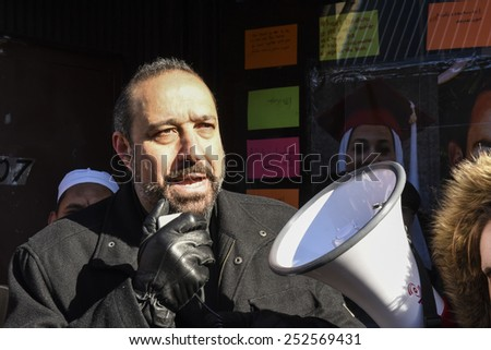 NEW YORK CITY - FEBRUARY 13 2015: Members of the Muslim community staged a vigil to call for justice in the killing of three Muslim Chapel Hill students. Christian minister addresses rally - stock photo