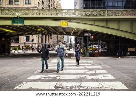 NEW YORK CITY - FEBRUARY 21, 2015:  View of Park Avenue at Pershing Square overpass with pedestrians in the intersection. - stock photo
