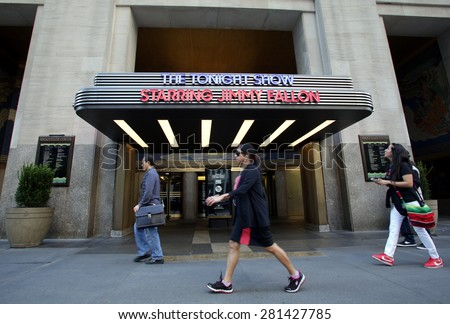 NEW YORK CITY - FRIDAY, MAY 8, 2015: Pedestrians walk past the entrance to the NBC television studio hosting The Tonight Show with Jimmy Fallon.     - stock photo