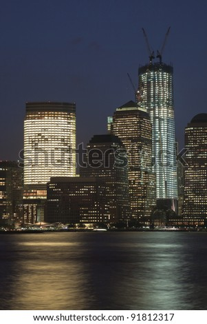 New York city in night and the Freedom tower - stock photo