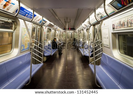 NEW YORK CITY - JAN. 10: A couple of passengers ride the NYC subway from World Trade Center on Jan 10, 2013. The NYC subway system contains 209 mi of routes and 468 stations. - stock photo