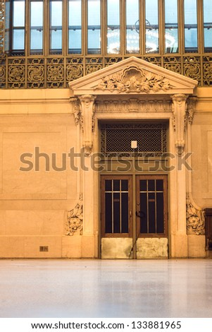 NEW YORK CITY - JAN 4: Antique door in Vanderbilt Hall in historic Grand Central Terminal in NYC on Jan 4  2013.  This Beaux Arts 12,000-square-foot hall once served as a   waiting room. - stock photo
