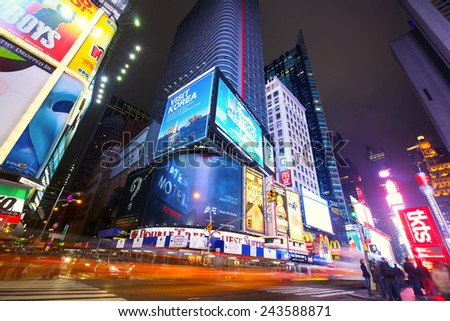 NEW YORK CITY - JAN 13: Busy traffic in Times Square with lots of illuminated billboards at night on January 13, 2013 in New York, NY, US. - stock photo