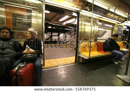 NEW YORK CITY - JAN 1: Commuters waiting on train on January 1, 2009 in NYC. The NYC Subway is one of the oldest and most extensive public transportation systems in the world, with 468 stations - stock photo