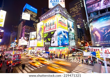 NEW YORK CITY - JAN17: Crossroad in Times Square and 7th Avenue with traffic, lots of illuminated billboards at night on January 17, 2013 in New York, NY, USA. - stock photo