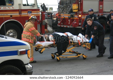 NEW YORK CITY - JAN 9: Person injured in a ferry accident at Pier 11 is brought to an ambulance in Lower Manhattan on January 9, 2013 in New York City, NY.