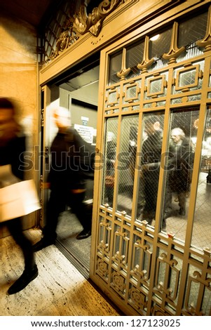 NEW YORK CITY - JAN 4: Rush of commuters through the doors at Grand Central Station on Jan 4, 2013 in NYC. This 100 year old terminal is the largest train station in the world with 44 platforms. - stock photo