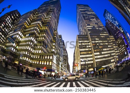 NEW YORK CITY - Jan 22: The Times Square at night on Jan 22, 2015 in New York, Times Square is major commercial intersection in New york and one of the most visited tourist attractions in the world. - stock photo