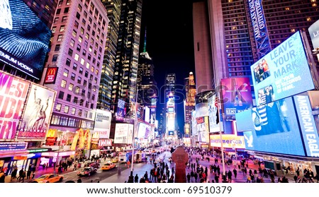 NEW YORK CITY - JAN 6: Times Square, featured with Broadway Theaters and animated LED signs, is a symbol of New York City and the United States, January 6, 2011 in Manhattan, New York City. - stock photo