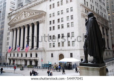 NEW YORK CITY - JAN 1: Wall Street with New York Stock Exchange in Manhattan Finance district during United States economy recovery, January 1, 2010 in Manhattan, New York City. - stock photo
