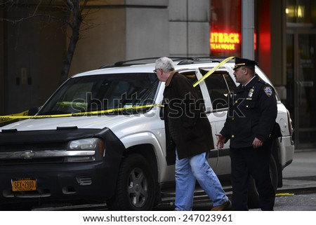 NEW YORK CITY - JANUARY 25 2015: a shooting at the Chelsea Home Depot store on 23rd Street left two employees dead. NYPD officers inspect vehicle possibly belonging to one of the victims - stock photo