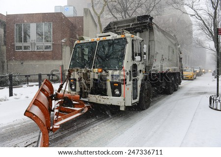 NEW YORK CITY - JANUARY 26 2015: Brooklyn Heights residents gird themselves in preparation for winter storm, Juno, the first major blizzard of 2015. Dept of Sanitation truck with snowplow - stock photo