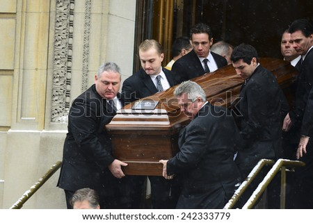 NEW YORK CITY - JANUARY 6 2015: funeral services were held for former New York governor Mario Cuomo at St. Ignatius Loyola Church on Manhattan's Upper East Side. Coffin carried out of church - stock photo