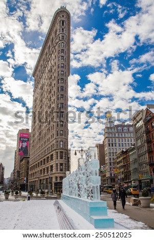NEW YORK CITY - JANUARY 9, 2015: Landmark Flatiron Building in midtown Manhattan with glass ice Shameless display in view.  - stock photo
