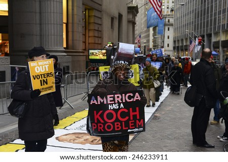 NEW YORK CITY - JANUARY 21 2015: several dozen activists gathered on Broad St by the NYSE to demonstrate in favor of campaign finance reform & play life-size Monopoly. - stock photo