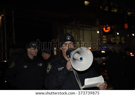 NEW YORK CITY - JANUARY 6 2016: Several dozen anti-rape activists mustered at Washington Square Park to protest a planned meet up by Return of Kings members. NYPD inform protesters they face arrest - stock photo
