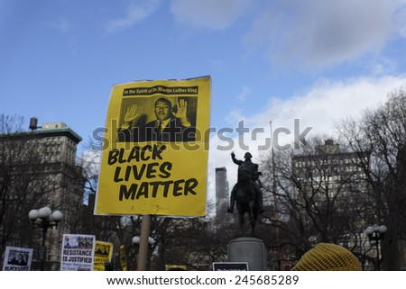NEW YORK CITY - JANUARY 19 2015: several hundred activists gathered at Union Square Park prior to starting the Four Mile March on Martin Luther King's birthday. - stock photo