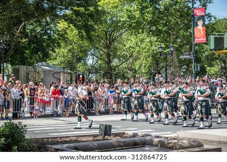 NEW YORK CITY - JULY 10: A band plays during the ticker-tape parade on July 10, 2015 in NYC. The parade has been organized to celebrate the U.S. women's soccer team's World Cup final win. - stock photo
