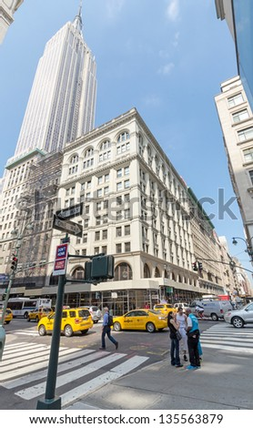 NEW YORK CITY - JULY 12: Cars drive down 35th street on July 12, 2012 in New York. Manhattan is a major commercial, economic, and cultural center of the United States. - stock photo
