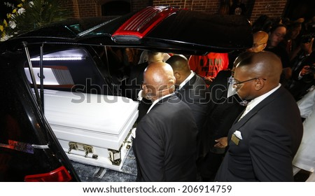 NEW YORK CITY - JULY 23 2014: Funeral services for Eric Garner, the Staten Island resident who died while being taken into custody by NYPD.  Eric Garner's coffin placed inside hearse - stock photo