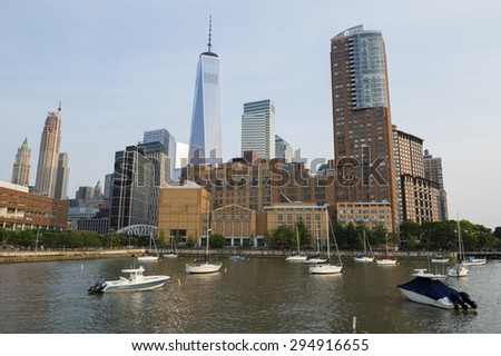 NEW YORK CITY, JULY 05, 2015: Hudson River view of the Downtown Manhattan skyline dominated by Battery Park City and World Trade Center. - stock photo
