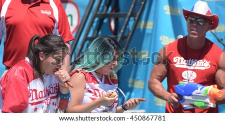 NEW YORK CITY - JULY 4 2016: Nathan's Famous Fourth of July Hot Dog Eating Contest marked the chain's centennial with Joey Chestnut & Miki Sudo winning top spots