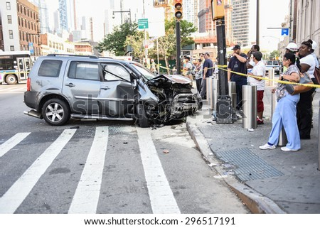 NEW YORK CITY - JULY 13 2015: NYPD collision investigators on scene at the intersection of Flatbush & Atlantic Aves where a hit & run collision led to the death of a bicyclist & multiple injuries - stock photo
