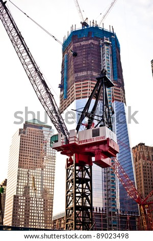 NEW YORK CITY - JULY 2: Ongoing construction on the World Trade Center on July 2, 2011 in New York, NY. Once completed it will be the tallest skyscraper in the USA. - stock photo