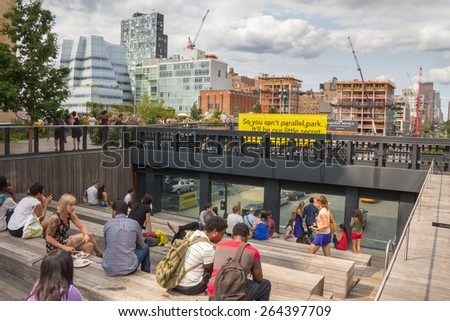 NEW YORK CITY - JULY 29,2014: People resting in High Line Park in New York. The High Line is a public park built on an old railway track elevated above the streets of Manhattan. - stock photo