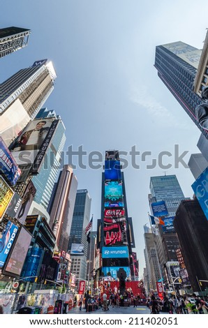 NEW YORK CITY - JULY 22: People visit Times Square on July 22, 2014 in New York. Times Square is a major commercial intersection in Manhattan, at the junction of Broadway and 7th Ave. - stock photo