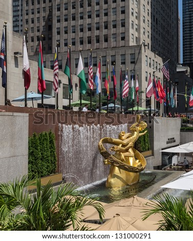 NEW YORK CITY - JULY 12: Prometheus Statue near Rockefeller Center on July 12, 2012 in New York. Rockefeller Center is a complex of 19 commercial buildings covering 22 acres. - stock photo