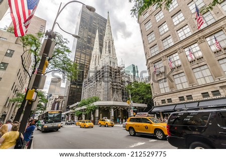 NEW YORK CITY - JULY 17: St. Patrick's Cathedral facade under reconstruction on July 17, 2014 in New York. The Cathedral of St. Patrick is a decorated Neo-Gothic-style Roman Catholic cathedral church. - stock photo