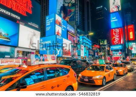 NEW YORK CITY - JULY 25, 2016: Street photo of Times Square. Times Square is a major commercial intersection and neighborhood in Midtown Manhattan, New York City
