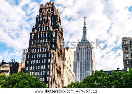 NEW YORK CITY - JULY 15, 2016: The American Radiator Building is a landmark skyscraper located at 40 West 40th Street, New York City. It was conceived by the architects John Howells and Raymond Hood