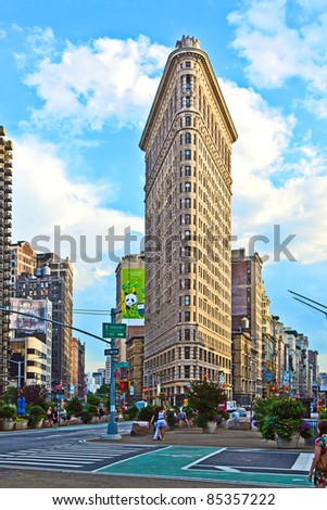 NEW YORK CITY - JULY 11: The Flatiron building in Manhattan July 11, 2010 in New York, NY. Considered a groundbreaking architectural feat, it was completed in 1902. - stock photo