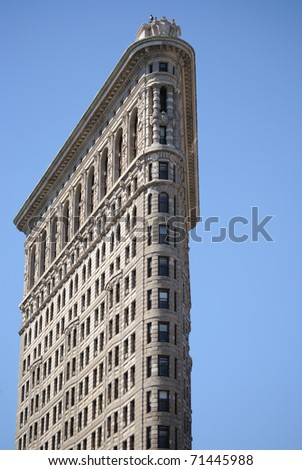 NEW YORK CITY - JULY 3: The Flatiron building in Manhattan July 3, 2010 in New York, NY. Considered a groundbreaking architectural feat, it was completed in 1902. - stock photo