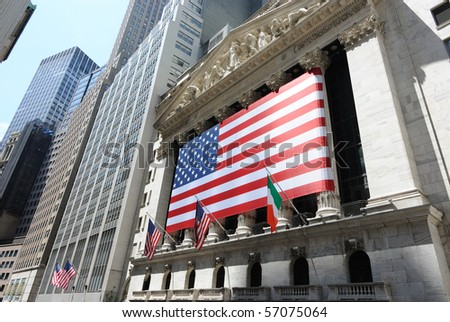 NEW YORK CITY - JULY 12: The historic New York Stock Exchange with giant American Flag July 12, 2010 in New York, New York. - stock photo