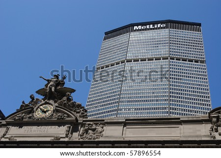 NEW YORK CITY - JULY 26: The MetLife Building and Grand Central Terminal July 26, 2010 in New York, NY. The MetLife Building was the last built before laws prevented corporate logos on building tops. - stock photo