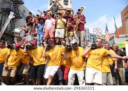 NEW YORK CITY - JULY 12 2015: the 125th annual Giglio Feast took place in Williamsburg, Brooklyn, in front of Our Lady of Mount Carmel church with participants hefting multi-ton gigli statues