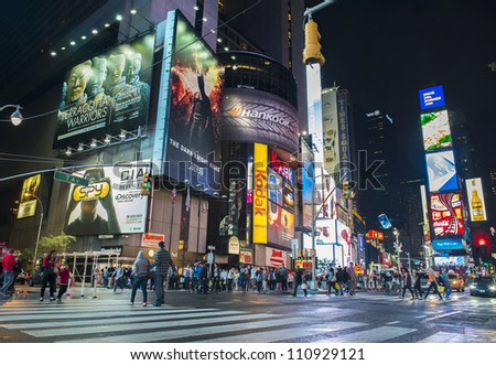 NEW YORK CITY - JULY 21 : The Times Square at night on July 21, 2012 in New York, Times Square is major commercial intersection in New york and one of the most visited tourist attractions in the world. - stock photo