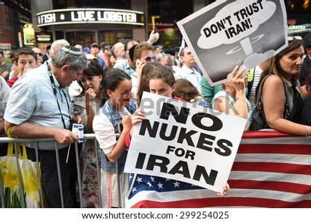 NEW YORK CITY - JULY 22 2015: thousands rallied in Times Square to oppose the President's proposed nuclear deal with Iran. Rally attendees with anti-Iran signs - stock photo