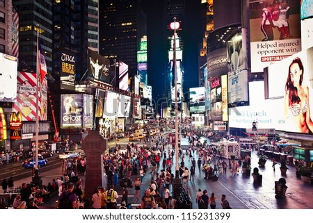 NEW YORK CITY - JULY 20: Times Square, is a busy tourist intersection of neon art and commerce and is an iconicplace  of New York City and USA on July 20, 2012 in Manhattan, New York City. - stock photo